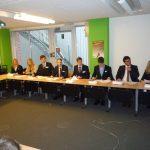 bei der Europäischen Kommission und einem Vortrag über Wettbewerbspolitik